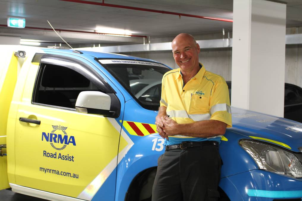 Helping: The NRMA's Glenn Stocker loves life on the road, changing tyres and using his ingenuity to get car keys out of unusual places.