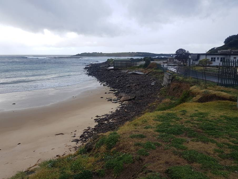The dark basalt rock of the damaged sea wall at Fishermans Beach, Port Kembla, is being rebuilt by Sydney Water.