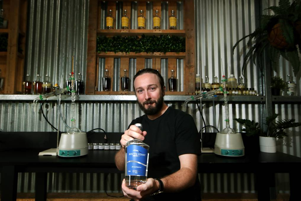 Medal: South Coast Distillery's Luke Harding shows off his favourite gin - the gold medal-winning Breakwater. Picture: Sylvia Liber