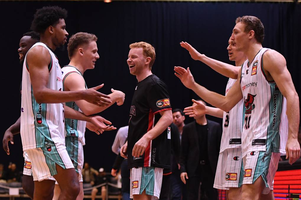 HAPPY: Illawarra Hawks players celebrate after claiming victory over the New Zealand Breakers in Launceston on Monday night. Picture: Steve Bell/Getty Images