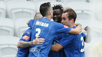 Jets players celebrate after Valentino Yuel (centre) scored a goal against the Phoenix at WIN Stadium on Sunday.Picture: Mark Metcalfe/Getty Images
