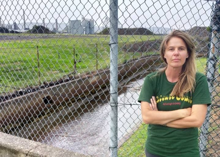 Raising concerns: Greens campaigner and Port Kembla resident Jess Whittaker near the drain site where she recently took water samples that showed extremely high levels of heavy metal pollution. Picture: Supplied.