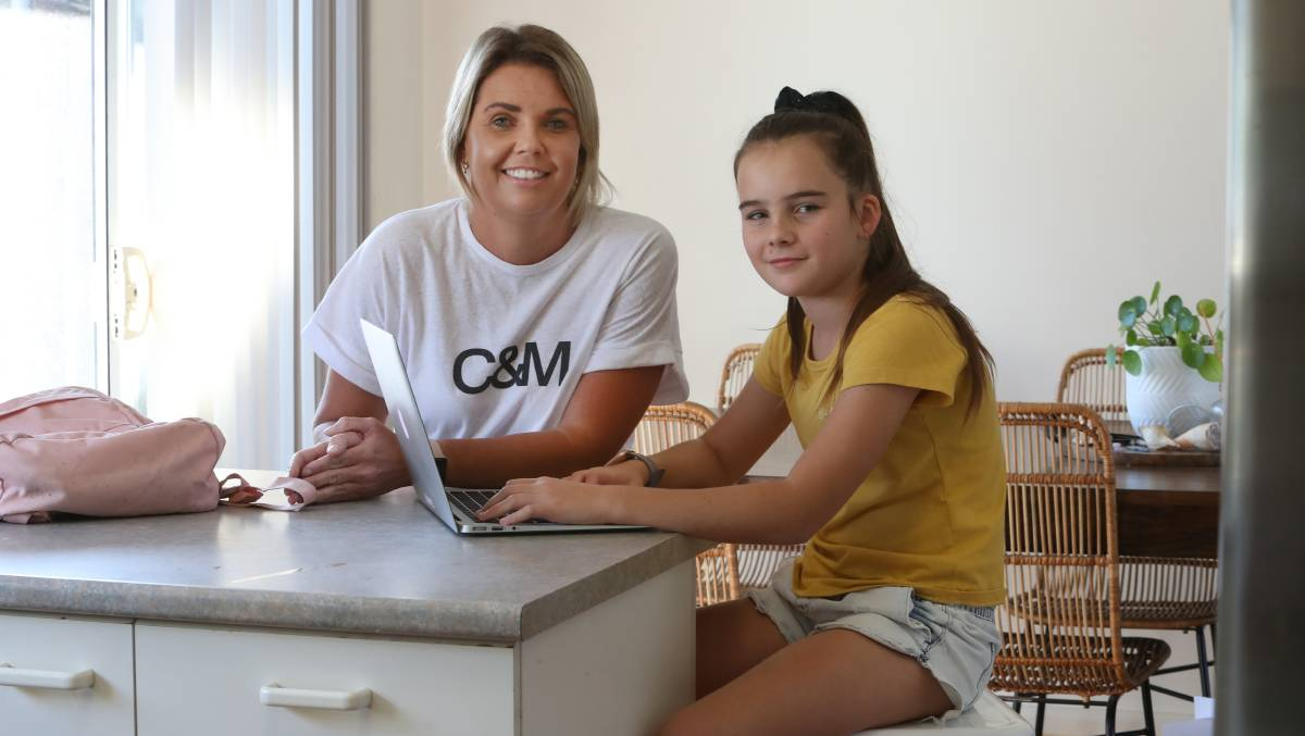 'It's been a challenge': Mum of six Karly Pilon with her daughter Milla who is in Year 6, says the return to full-time classes will benefit her kids in cruicial years at school. Picture: Robert Peet.