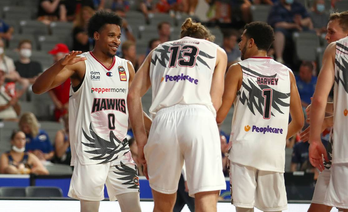 STAR: Justin Simon (left) produced an impressive first outing in the Hawks win over Brisbane on Saturday night. Picture: Getty Images