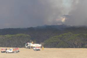 FIRE BOMBER: One of three Aerotech Air Tractor 802 F (AT 802F) fire-bombing air tankers at work on the fire at Redbanks on Kangaroo Island. Photo Stan Gorton