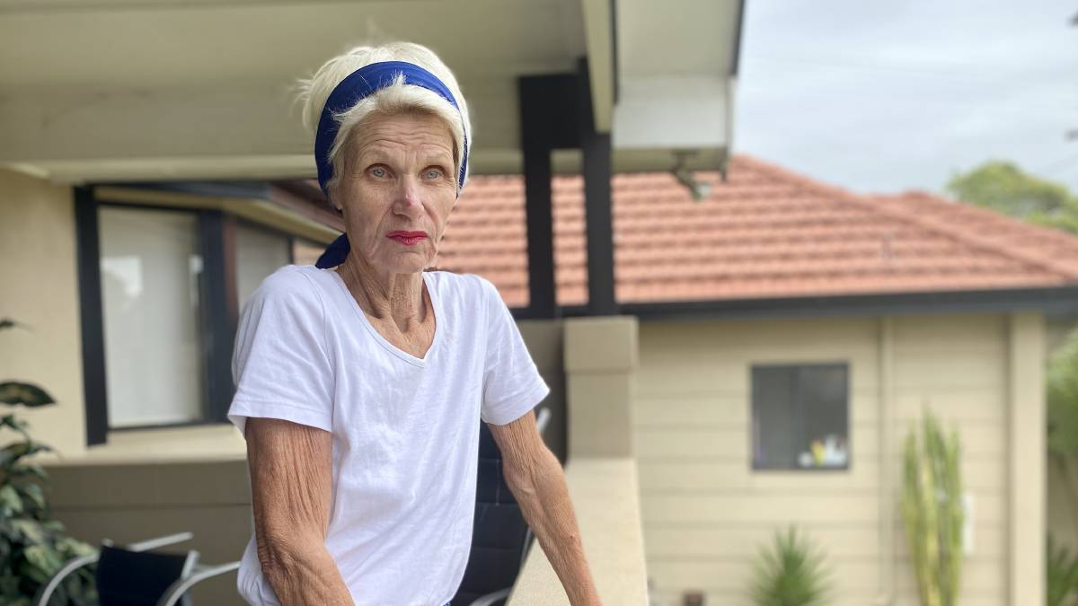 Donna Porcella surveys the street from her Fitzwilliam Street balcony, where a masked intruder grappled with her Good Samaritan neighbour. Picture: Angela Thompson