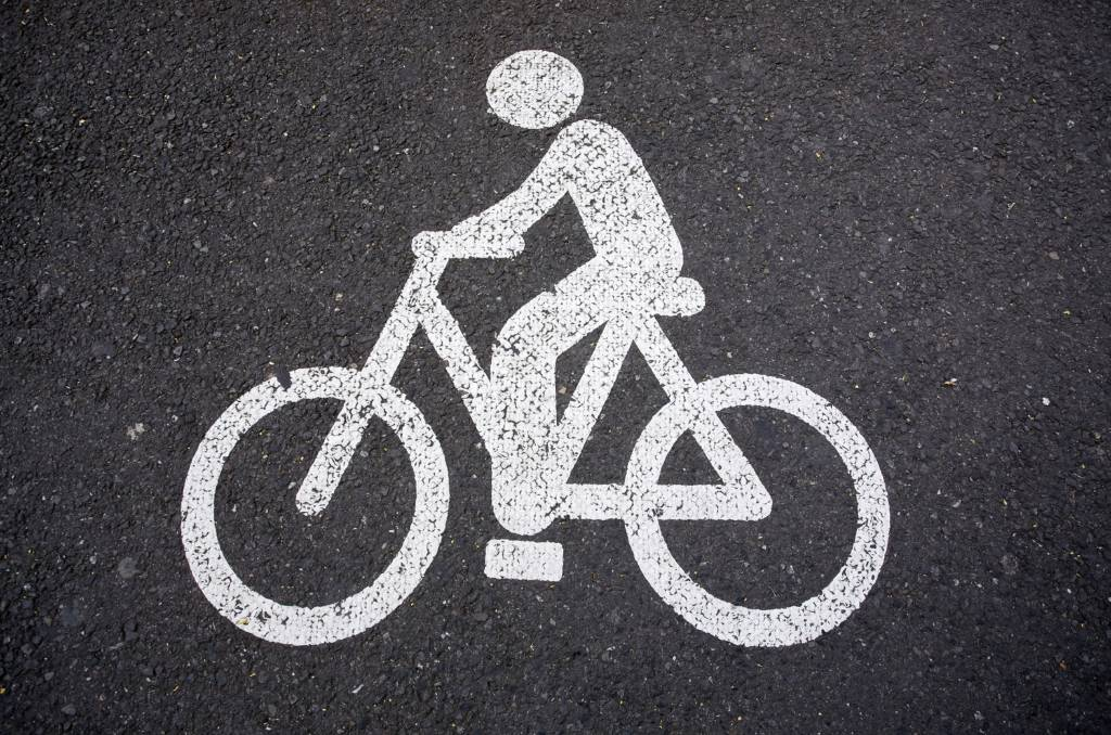 Contrary to what some people claim, a cyclist riding on the road is not breaking the rules around obstructing traffic.