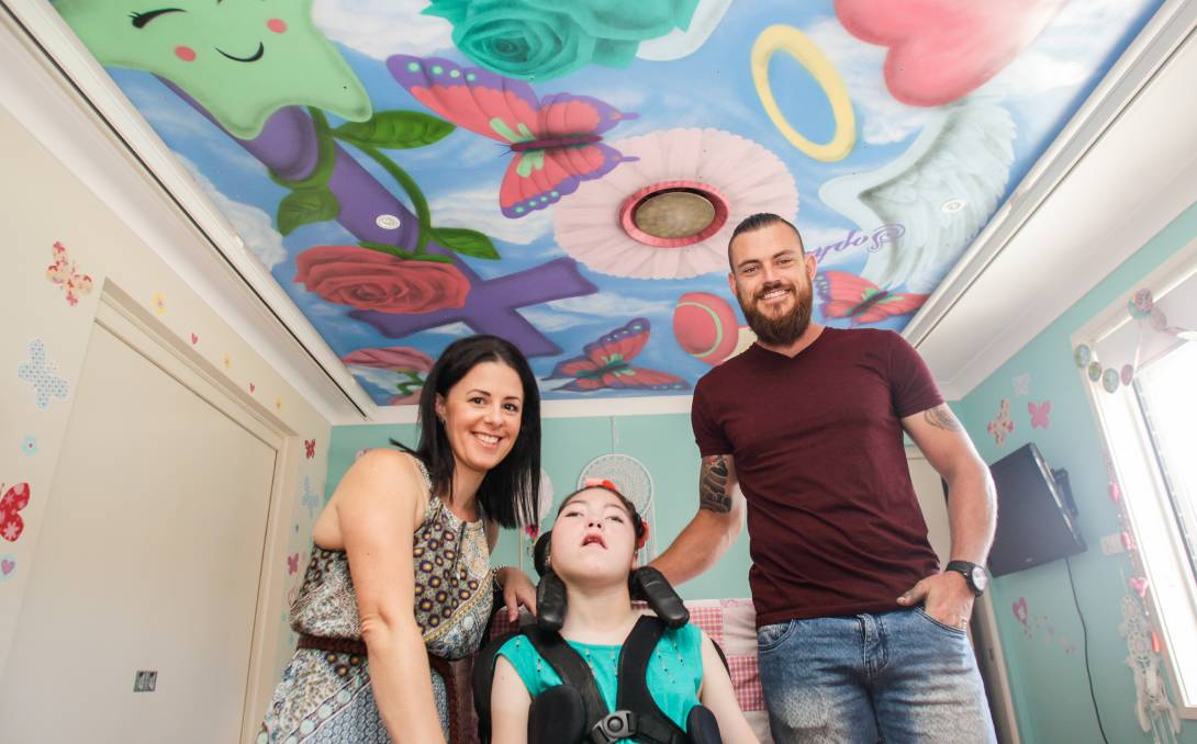 Precious piece: Sophie Macaulay with her mother Shanna Priestly and aerosol artist Anthony Jones who painted the mural. Picture: Georgia Matts