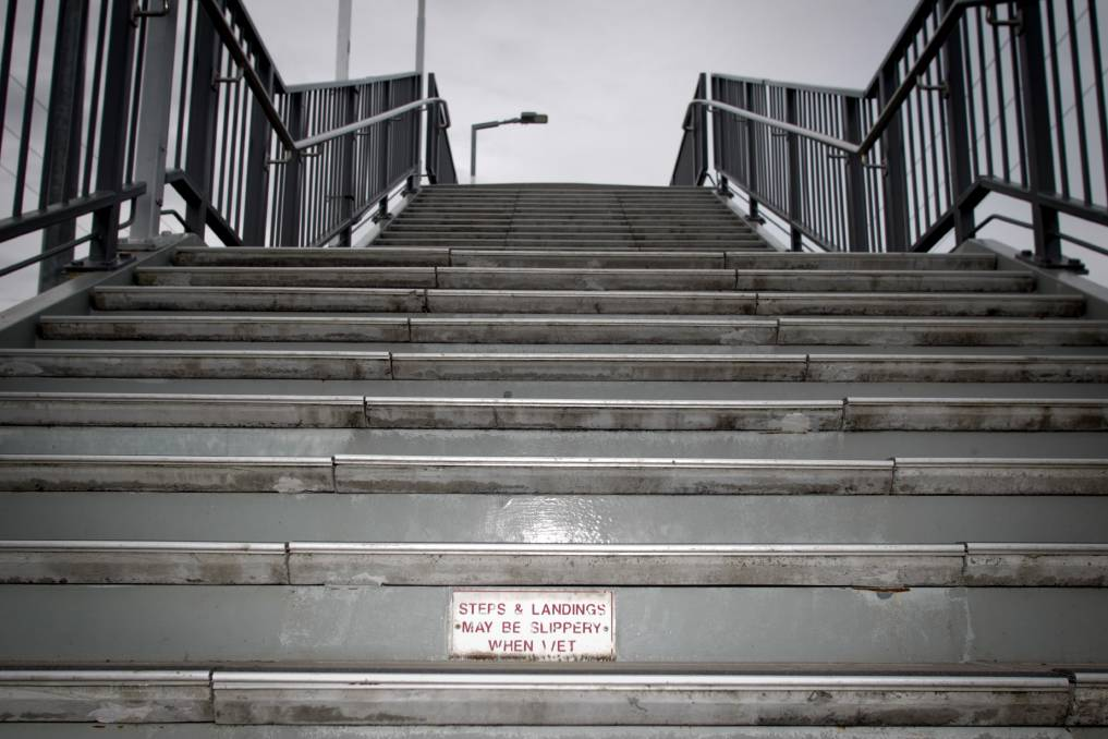 The awarding of a contract to replace the stairs at Unanderra station with lifts has been delayed until early next year. Picture: Georgia Matts