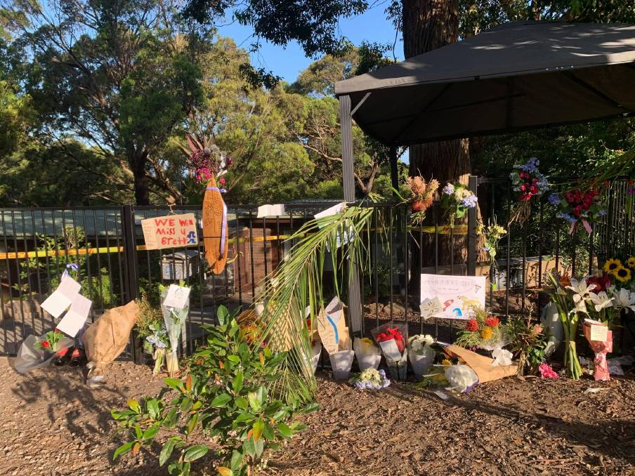 OUTPOURING OF LOVE: The memorial which has taken shape outside Mr Harris's house off Lawrence Hargrave Drive. Picture: Luke Shanahan.