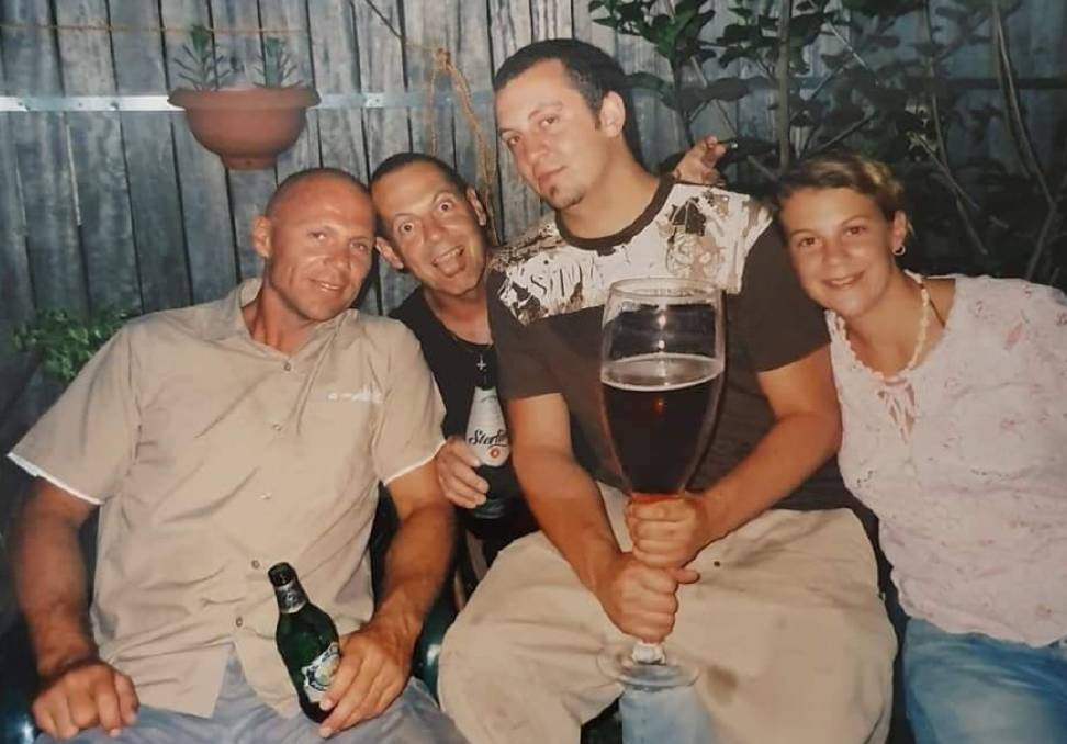GLASS HALF FULL: Brett Harris (left) enjoying himself with brother Michael, nephew Mitchell and neice Nerida. Picture: supplied by Michael Harris.