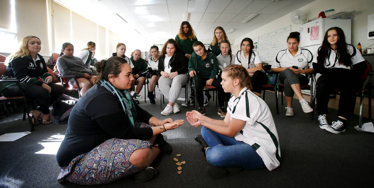 Building resilience: Aboriginal social worker Denika Thomas with Oak Flats High student Cinnamon-Lee McGregor and classmates at a Journey Stones session to put them in touch with their emotions. Picture: Sylvia Liber