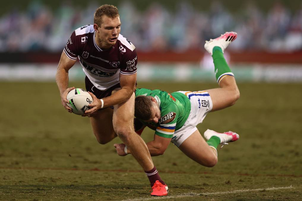 Manly's Tom Trbojevic is tackled during last Sunday's match against the Canberra Raiders. Photo: Cameron Spencer/Getty Images