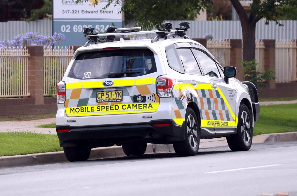 CHANGES: A mobile speed camera vehicle parked on the side of a suburban road. The 45 vehicles deployed statewide will soon have their high-visibility decals either reduced or removed. Picture: Les Smith