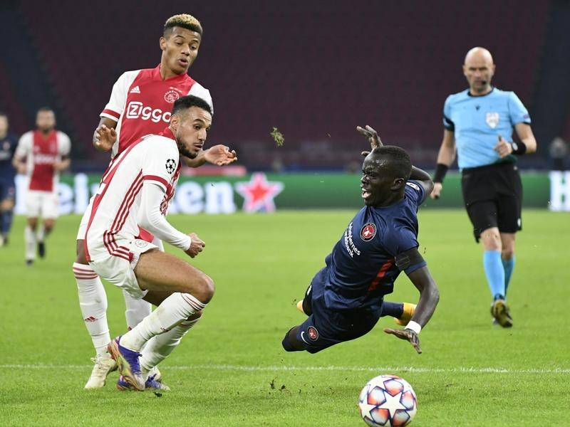 Socceroo Awer Mabil (r) scored for Midtjylland in their 3-1 Champions League defeat to Ajax.