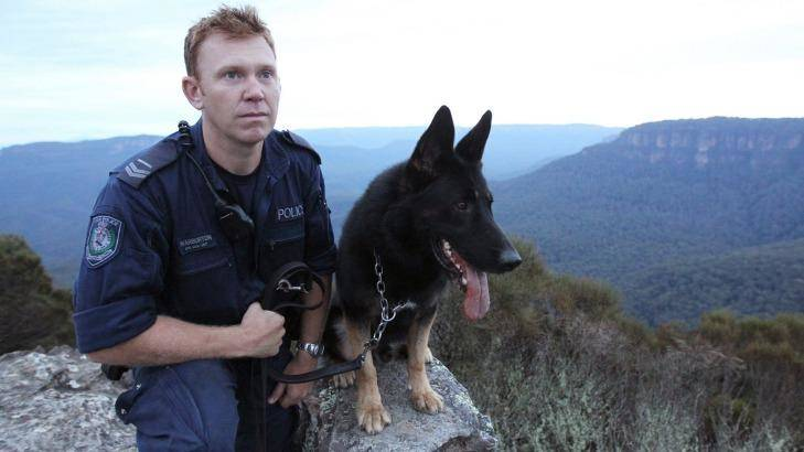 Senior Constable Luke Warburton, pictured with his dog Chuck, is in a critical but stable condition. Photo: David Darcy