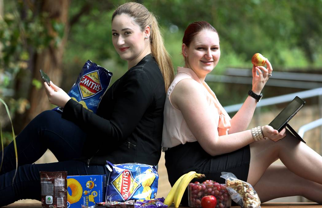 UOW honours psychology students Alexandra Rodriguez and Tegan Blackburne want people to make healthy food choices. Picture: ROBERT PEET