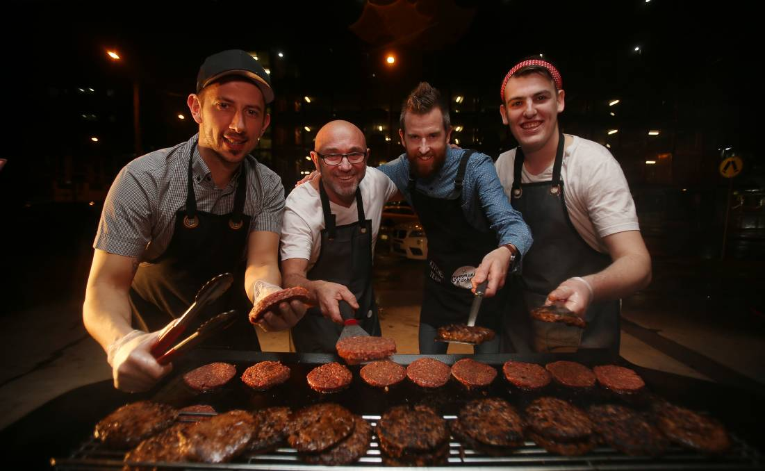 Cooking up a storm: Robert Gorgievski, Lube Markovski, Josh Hammann and Adam Moran at Lighthouse Community Kitchen. Picture: Robert Peet