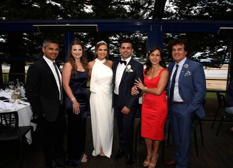 Wedding save: John and Aleida Dwarte, Sharnae and James Dwarte and Katia and Glenn Dwarte at the Lagoon Seafood Restaurant on Saturday. Picture: Greg Ellis.